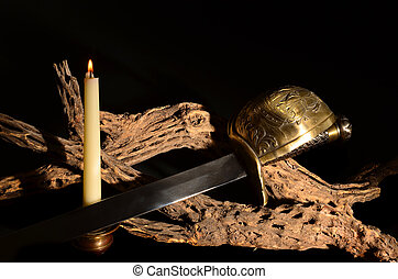 Saber Sword - Old saber sword with candle and cholla