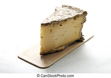 Piece of french cheese: Tomme Savoy on white background