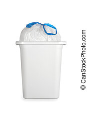 White trash can with plastic garbage bag - A white trash can...