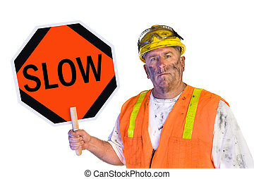 Construction worker holding a slow sign - A dirty, grungy,...