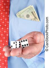 Businessman holding dice