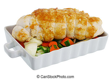 Bound grilled turkey breast with vegetables on baking pan...