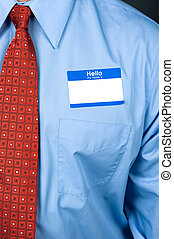 Businessman wearing blank nametag - A businessman wearing a...