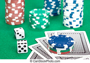 Poker table gambling setting with chips, cards and dice