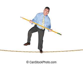 businessman balancing on tightrope - A businessman balancing...