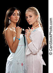two beautiful young women - Portrait of a two beautiful...