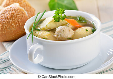 Delicious wedding soup with semolina dumplings, bone marrow...