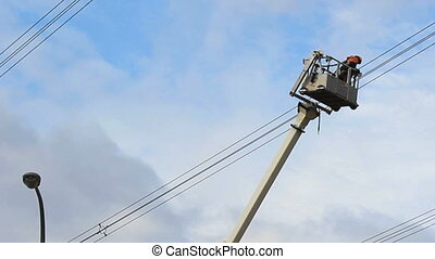 Hydro Worker Stuck In Bucket On Job - A hydro worker looks...