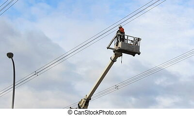 Hydro Worker Swings By In Bucket - A hydro worker finished...