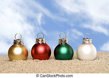 Christmas ornaments on the beach - Four Christmas ornaments...