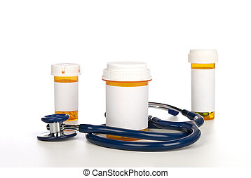 Pill bottles with blank labels and stethoscope