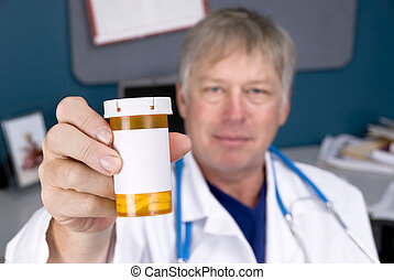 Doctor holding pill bottle - A doctor holds out a pill...