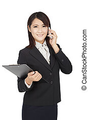 asian business woman using phone and holding a folder
