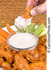 Chicken hot wings and dipping sauce - A dish of chicken hot...