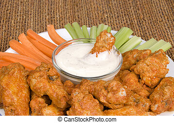 Chicken hot wings and dipping sauce - A spicy plate of...