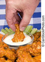 Chicken hot wings - A dish of chicken hot wings, celery and...