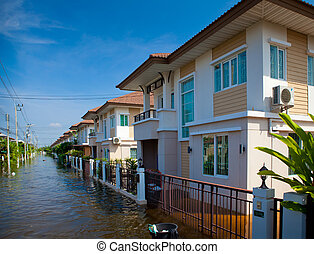 house flood in Thailand - flood waters overtake house in...