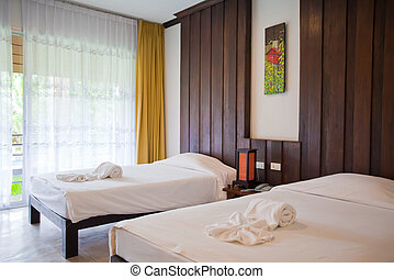 Hotel room with bed and wooden - Hotel room in a tropical...