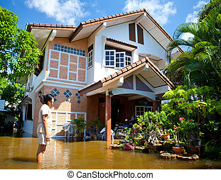 flood waters overtake house in Thailand - AYUTTHAYA -...