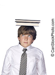 Boy balancing book on head