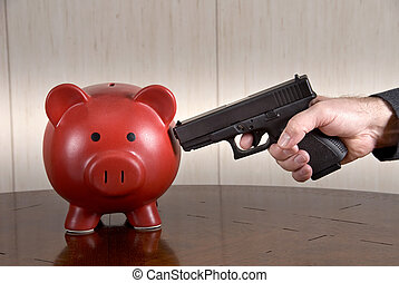 Shooting piggybank - A man ready to take out his broke piggy...