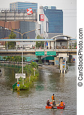 People uses boat as a transportation - BANGKOK, THAILAND -...