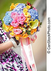 beautiful flower bouquet holded in hand