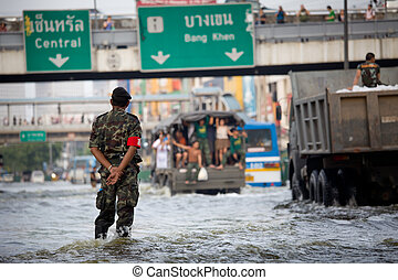 Rescue teams helping people - BANGKOK, THAILAND - NOVEMBER 5...