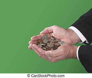 Man holding coins - A man holds a pile of coins in his...