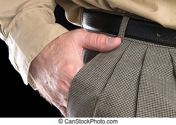 Man with hand in suit pocket