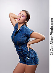 Sexy girl posing in jeans dress show desire