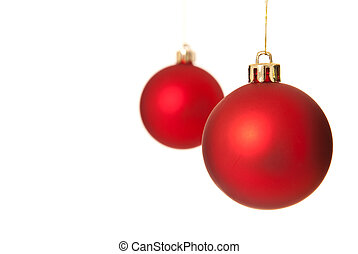 Two red christmas tree ball ornaments Isolated on white...