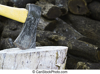 ax on chopping block wood in background 1 - an ax on a...