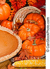 Pumpkin pie with autumn leaves and pumpkins. - Pumpkin pie...