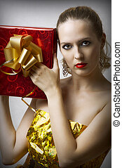 young glamour woman with christmas gift box