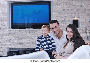happy young family have fun with tv in background - happy...