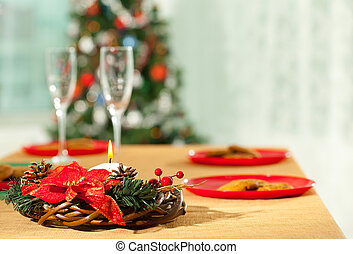 Christmas dinner - Image of holiday wreath with flutes and...