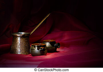 Coffee still life over abstract textile backgrounds