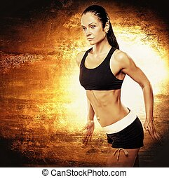 Athletic woman on golden background.