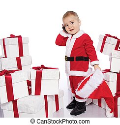 Baby boy in Santa Claus costume  with mobile phone