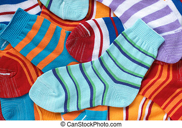 Many pairs of childs striped socks, for backgrounds or...