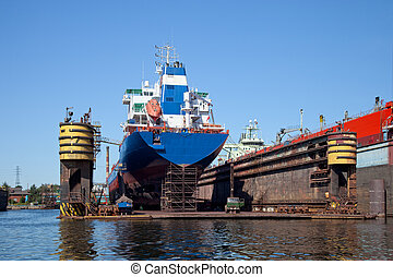 Ship in dry dock - Big ship to dock at the shipyard.