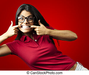 happy woman - portrait of happy young woman doing a grimace...