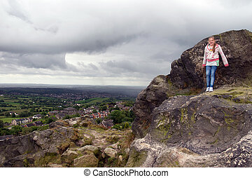 girl on cliff with view of English cheshire countryside -...