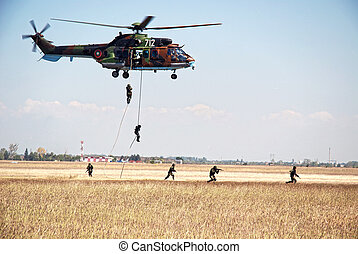 Helicopter dropping marines - Helicopter cougar dropping...