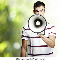 young man shouting - portrait of young man shouting using a...