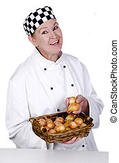 female chef holding a basket with onions in her hand