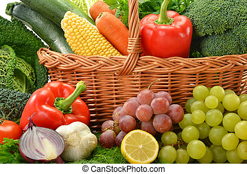 Composition with vegetables and fruits in wicker basket...