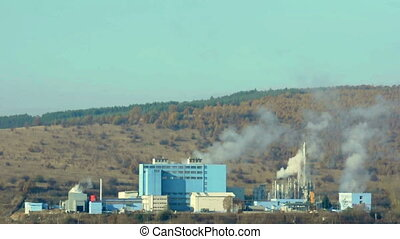 Industrial factory with chimneys an