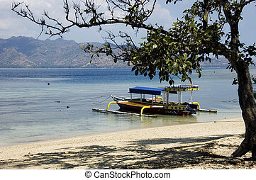 Colored pump boat and view of Lombok island from Gili Air,...